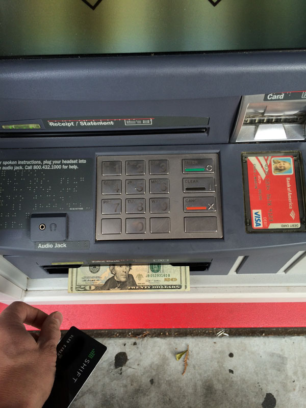 09-withdrawing-cash-from-atm-using-bitcoin-debit-card-USD100