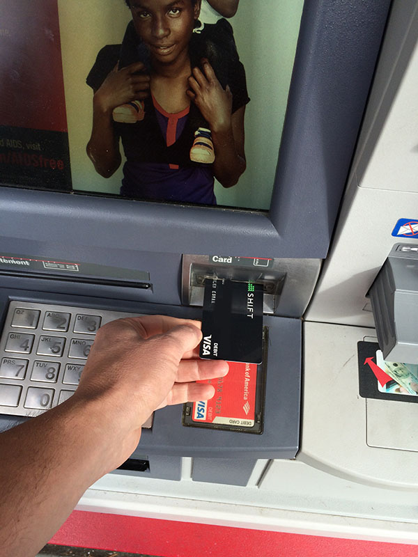09-withdrawing-cash-from-atm-using-bitcoin-debit-card